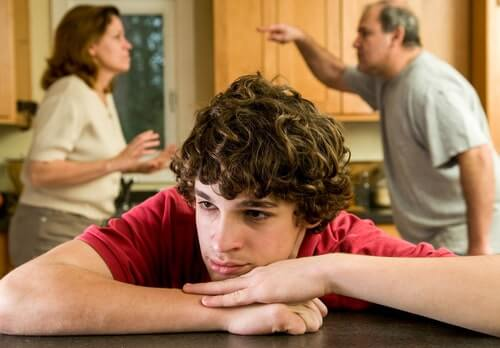 Teenager while parents argue - Divorce